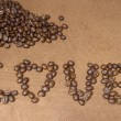 Love alphabet by coffee beans on wood board — Stock fotografie