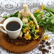 Wooden doll and espresso — Stock Photo