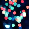 Multicolored christmas bokeh lights background — Stock Photo