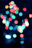 Multicolored christmas bokeh lights background — Foto Stock
