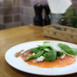 Fresh rocket green salad with salted salmon, selective focus — Stock Photo