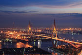 Bangkok view of Bhumibol Bridge across Chao-praya river at night — Stock Photo