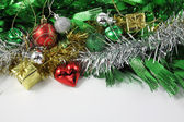 Christmas ornaments border decoration on white background — Stock Photo