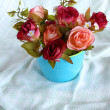 Rose flower in blue cup — Stock Photo #38652523