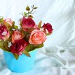 Rose flower in blue cup — Stock Photo #38652525