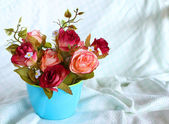 Rose flower in blue cup — Stock Photo