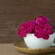 Pink rose in white coffee cup — Stock Photo #39144437