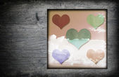 Vintage wood frame with hearts icon and blue sky white clouds — Stock Photo