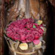 Old paper pink roses on grunge wood teak shelf in vintage style — Stock Photo #39991847