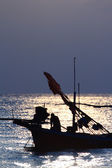 Stunning sunset over sea and sky with fishing boat floating — Stockfoto