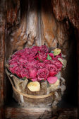 Old paper pink roses on grunge wood teak shelf in vintage style — Stock Photo