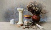 Still life with candle, seashell,dry roses and grunge paper on wooden table — Stock Photo
