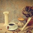 Still life cup of coffee,candle, seashell,dry roses and grunge paper — Stock Photo