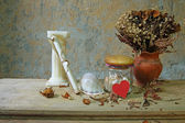 Still life with red heart,candle, seashell,dry roses and grunge paper — Stock Photo