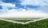 Corner soccer green grass field with blue sky white clouds — Stock Photo