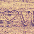 Heart shape drawn on beach sand — Stock Photo