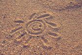 Sun drawn on sand — Stockfoto