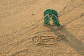 Flip flops and heart shape — Stock Photo