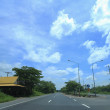 Road in countyrside with blue sky background — Stock Photo #48240239