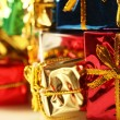 Stack of shiny presents - Stock Photo