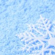 Snowflake in snow — Stock Photo