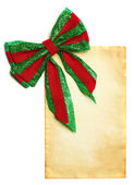 Christmas bow with blank paper — Stock Photo
