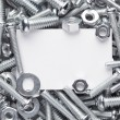 Nuts and bolts frame — Stock Photo