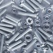 Stock Photo: Nuts and bolts background
