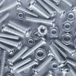 Nuts and bolts background — Stock Photo