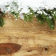 Christmas decorations covered in snow — Stock Photo