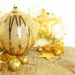 Golden Christmas ornaments — Stock Photo #35578625