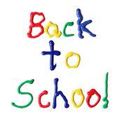 Back to school written in paint — Stock Photo