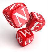 Palabra nueva en dados caja roja — Foto de Stock