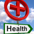 Health road sign with red cross — Stock Photo