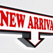 New arrival red and black arrow sign - Stock Photo