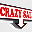 Crazy sale red and black arrow sign — Stock Photo
