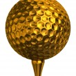 Golf ball gold on tee - Stock Photo