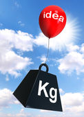 Idea sign on red balloon lifting weight — Stock Photo