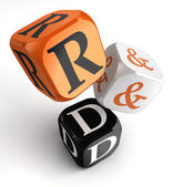 R&d orange black dice blocks — Stock Photo