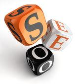 Seo orange svart tärning block — Stockfoto