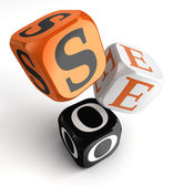 Seo orange black dice blocks — Stock Photo