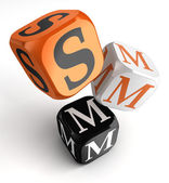 Smm orange black dice blocks — Stock Photo