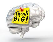 Think big note paper on brain — Stockfoto