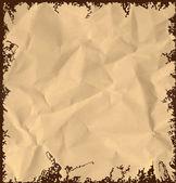 Old crumpled paper background. — Stockvektor