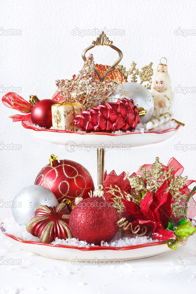 Red and white Christmas compisition on a cupcake stand.  Stock Photo #13288922