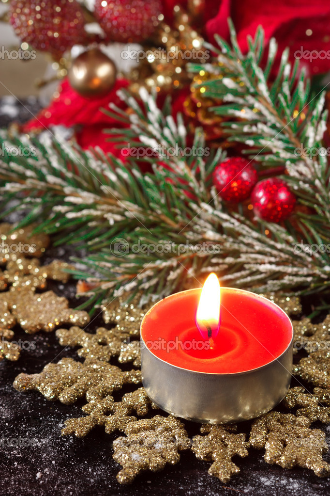 Red christmas candle on a golden snowflake.  Stock Photo #13533270