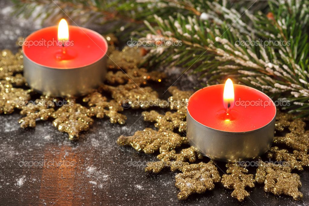 Red christmas candles on a golden snowflakes. — Stock Photo #13764478