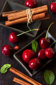 Sweet cherry and cinnamon. — Stock Photo