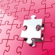 Puzzle jigsaw background with one piece stand out — 图库照片