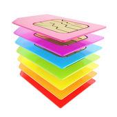 多彩堆栈的手机 sim 卡与电路芯片 — 图库照片
